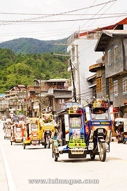 tricycles traffic in mountain town
