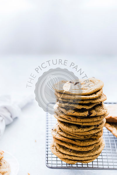 Stack of Chocolate Chip Cookies  on a cooling wire rack