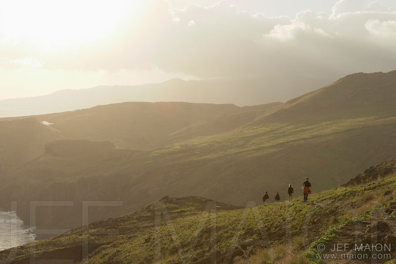 Hikers above the sea