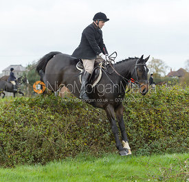 Jeremy Dale jumping a hedge near the meet in Long Clawson