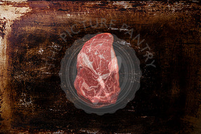 Raw fresh marbled meat Steak Rib eye Black Angus on dark metal background