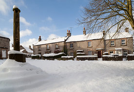 Great Longstone village cross in snow
