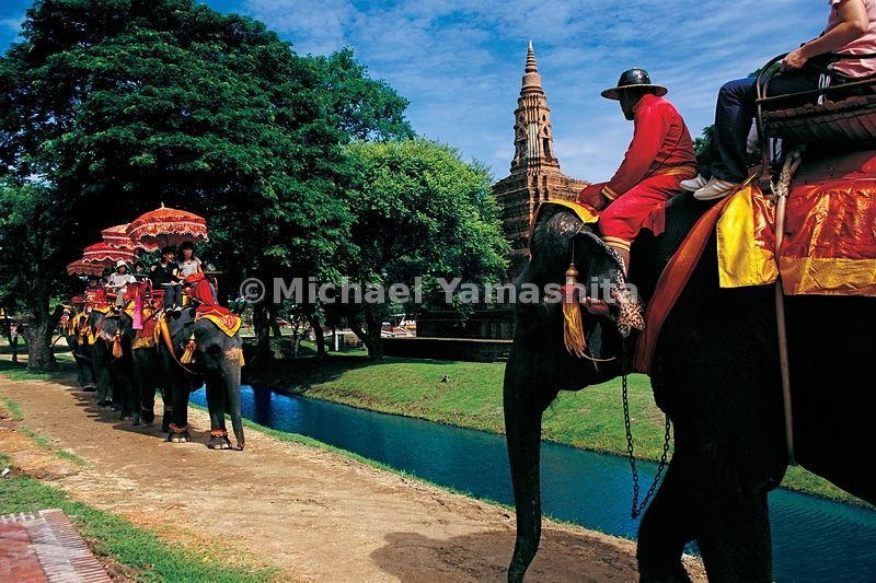 Tourists ride elephants once reserved for kings.