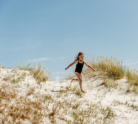 Girl at Dueodde beach on Bornholm, Denmark 4