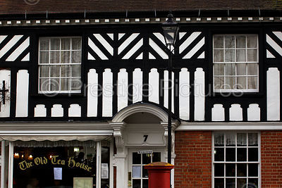 Black and White Timbered Building with Old Tea House Sign in Window