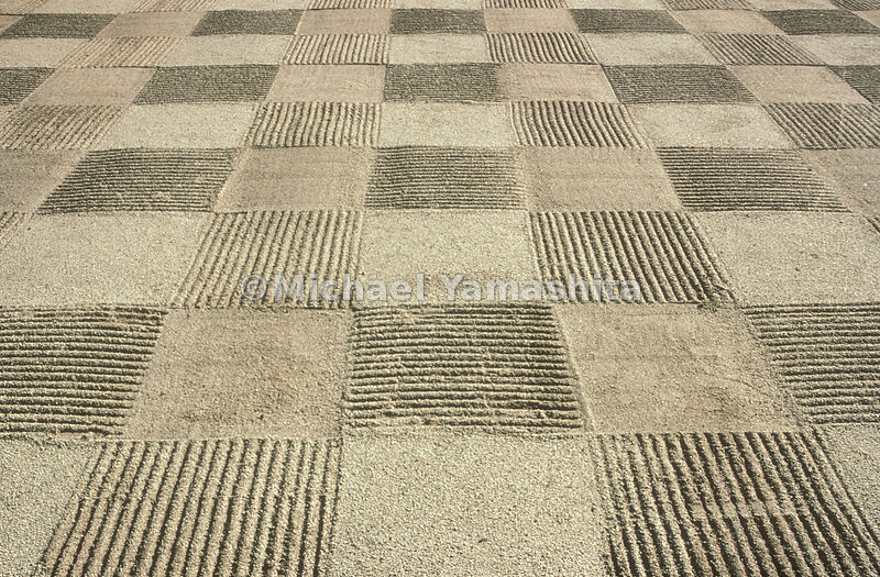 At the temple of Tofukuji in Kyoto a checkerboard pattern of coarse sand imposes an artful symmetry on an ever shifting medium. Decorative raked patterns traditionally conjure up visions of ripples, scalloped waves, streams, and whirlpools.