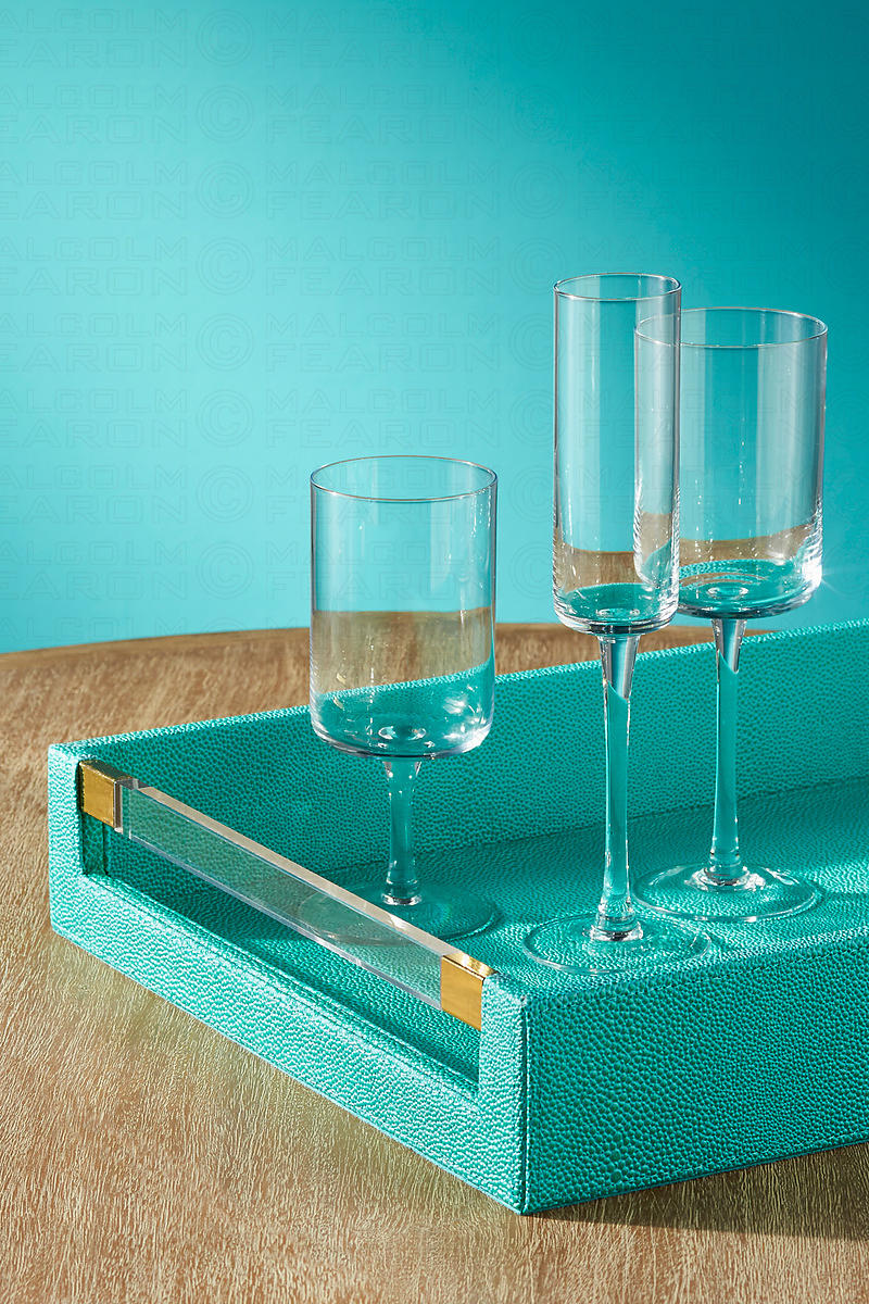 glass collection on turquoise tray