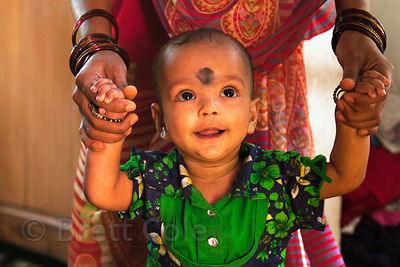 A darling baby at her house in the Fakir Bagan neighborhood of Howrah, India, in an area served by the NGO Calcutta Kids (calcuttakids.org)