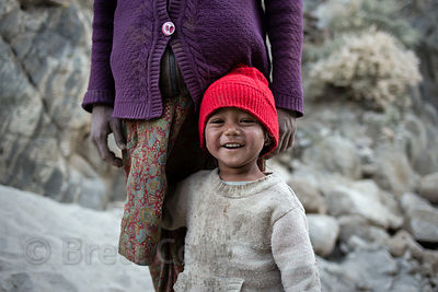 Nepalese family working at a construction site near Phyang village, Ladakh, India. The pregnant mother works hauling rocks all day for 200 rupees a day (US $3 per day).