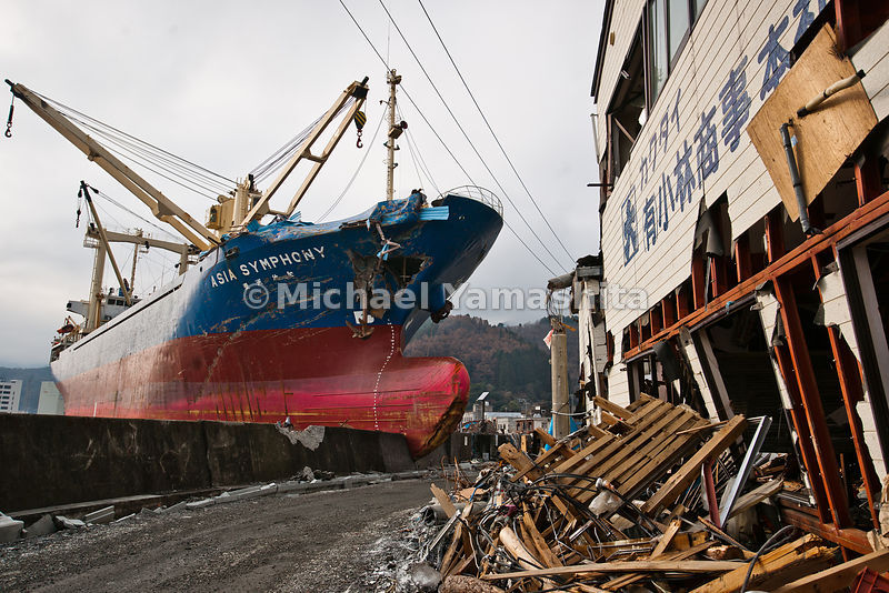 March 11 Great Eastern Japan Earthquake and Tsunami. Measuring 9, biggest ever to hit Japan destroying the NE coast line cities and villages for 200 plus miles. Freighter called Asia Symphony left pushed up on a barrier next to the road.