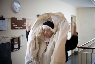 Nuns getting changed into their robes