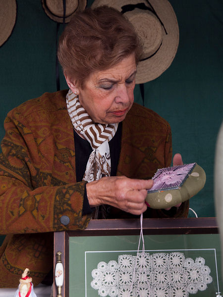 a woman demonstrating lace-making in Haria