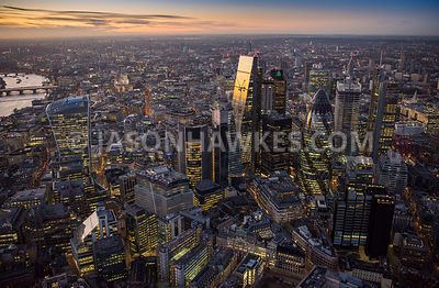 Aerial view of  City of London, 30 St Mary's Axe with Leadenhall Building  and financial district at nightime.