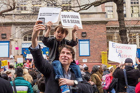 Children and parents protest the ELA exam at a New York City elementary school.