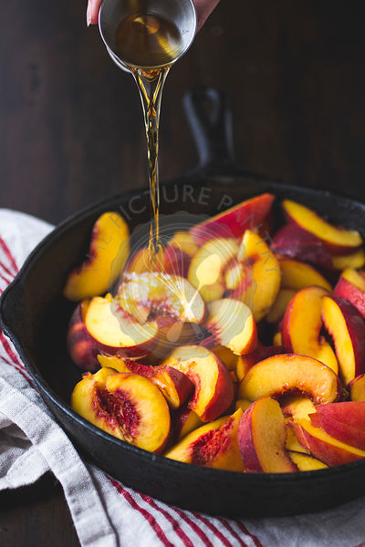 Sliced Peaches in a Cast Iron Skillet with Whiskey