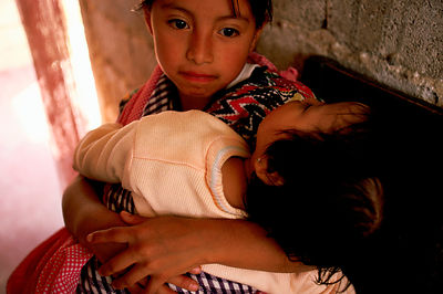 Mayan girl looks after her brother
