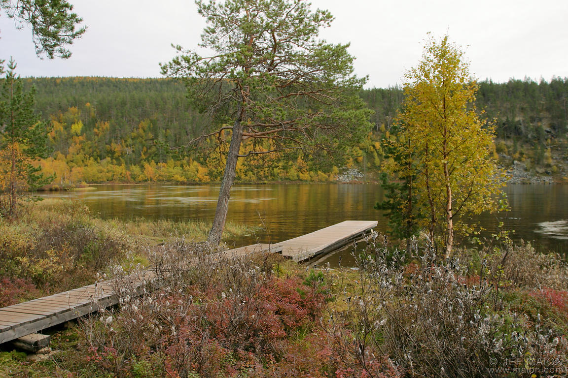Wooden pier on Lemmenjoki river