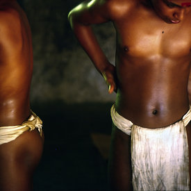 Boys oil themselves before a massage by a teacher at the Kerala Kalamandalam, Kerala, India