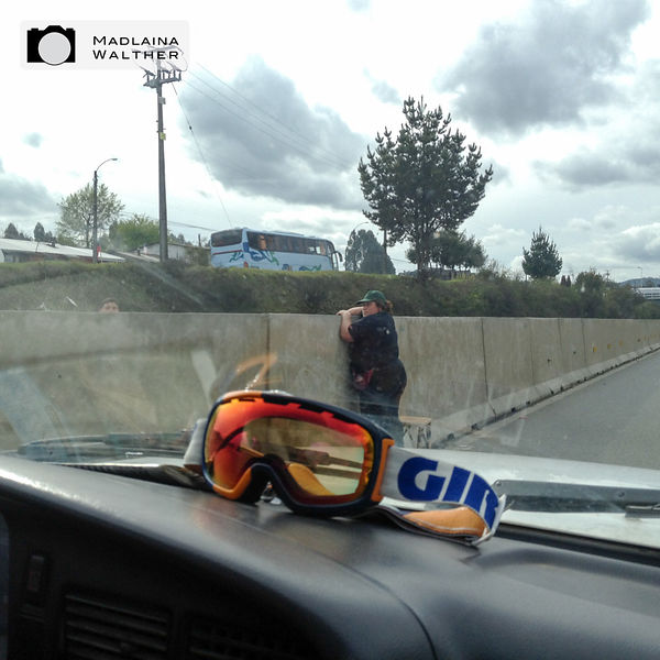 Chilean highway 1: this woman is standing besides a chair and tries to get on the other lane