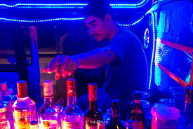 A street bar in a vehicle at night in Bangkok, Thailand.