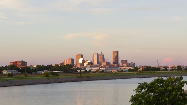 Medium Shot: Sunset Over Oklahoma City Skyline & Oklahoma River