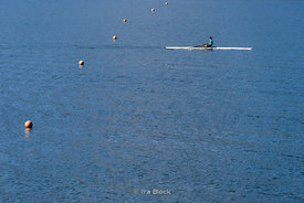 A man enjoying rowing at Lake Kawaguchi, the second largest of the Fuji Five Lakes in terms of surface area,