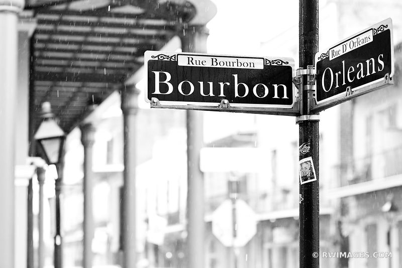 BOURBON STREET RAINY DAY FRENCH QUARTER NEW ORLEANS BLACK AND WHITE