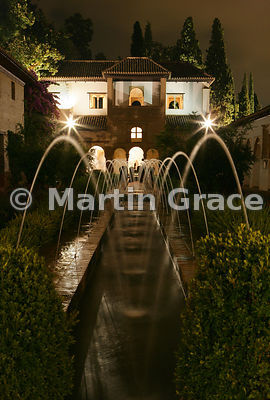 The East Pavilion beyond the Patio de la Acequia (Water Garden), both illuminated at night, Generalife, Granada, Andalusia, Spain