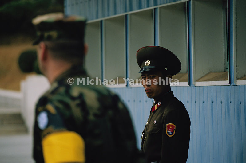 A North Korean sentry shows his war face to an American officer, part of the United Nations Military Armistice Commision .