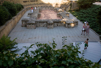 Hungary - Pecs - Children play over the ruins of the early Christian Tomb