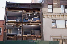 Hurricane Sandy ripped the facade off a building in New York's Chelsea neighborhood, leaving apartments exposed to the world as if in a giant dollhouse.