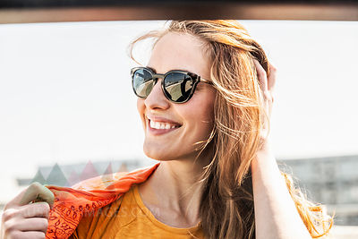 Portrait of smiling woman wearing sunglasses