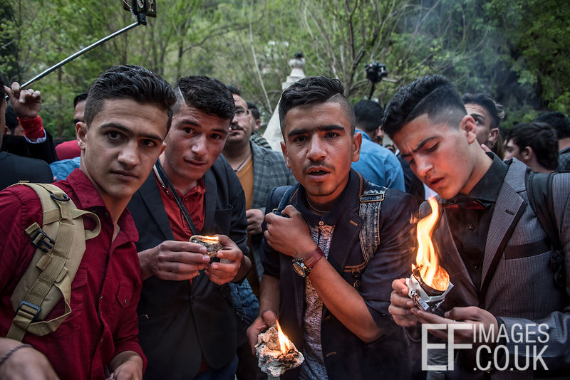 Young men with oil lamps celebrating Yazidi New Year, or Sere Sal
