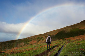 Rainbow and hiker