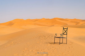A chair in the Erg Chebbi Sand dunes of the Sahara Desert in Morocco