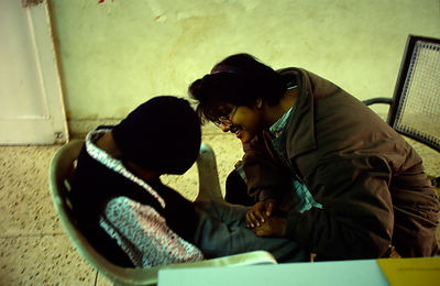 India - Delhi - A social worker offers counselling