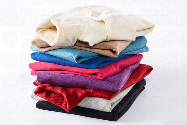 stack of polo neck sweaters
