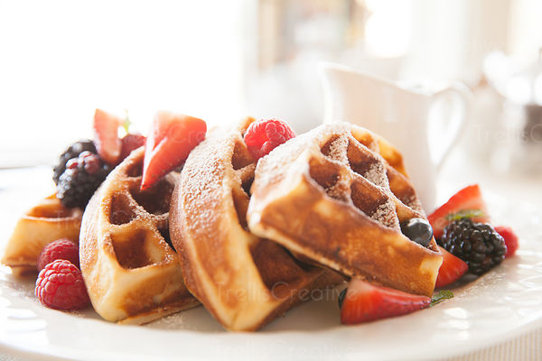 Close-up of indulgent delicious waffles with berries