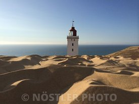 Lighthouse covered in sand