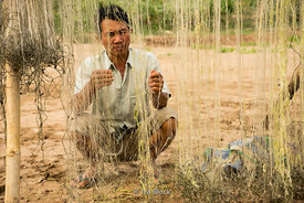A fisherman with his net near the Mekong River in Laos.