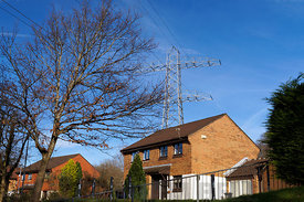 House and high voltage power lines, Whitchurch, Cardiff, Wales.