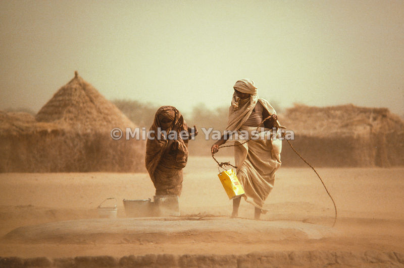 People collecting valuables in their village in the country of Sudan.