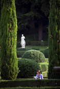 Italy - Verona - A woman reading a map in the Giardini Giusti,