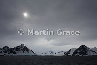 Cold, inhospitable landscape at most southerly point reached (68 degrees 15 secs), Marguerite Bay, Antarctic Peninsula