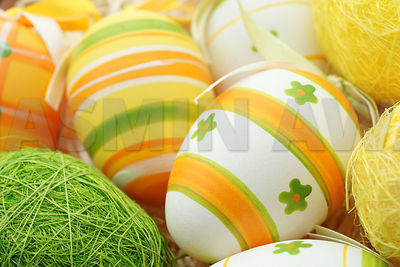 Easter Eggs with stripes in yellow and green