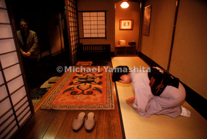 An employee of the  Tawaraya Inn bows to greet guests. Etiquette in Japan is expressed both with physical gestures and the careful use of complicated honorific language.