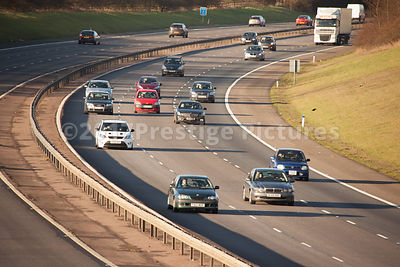 Vehicles speeding along the three lane motorway