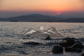 July 4, 2015. The sun sets over the Ocean in Vancouver BC. Photo by Brad Kasselman - coastphoto.com
