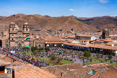 Throng of onlookers during the extravagant Cusco Week festivites, held each year in June leading up to the Inti Raymi festival, Cusco, Peru