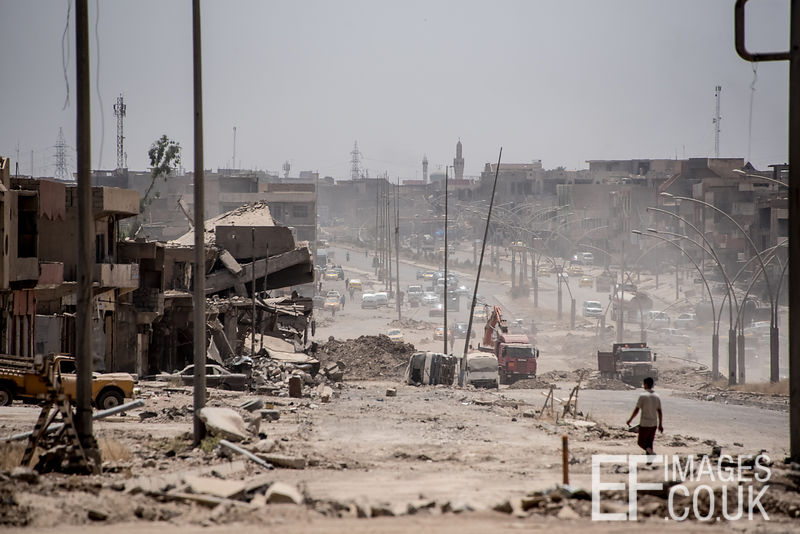 The main road through Kanisa, being cleared with bulldozers and dump trucks. Mosul, Iraq, 5th June, 2017